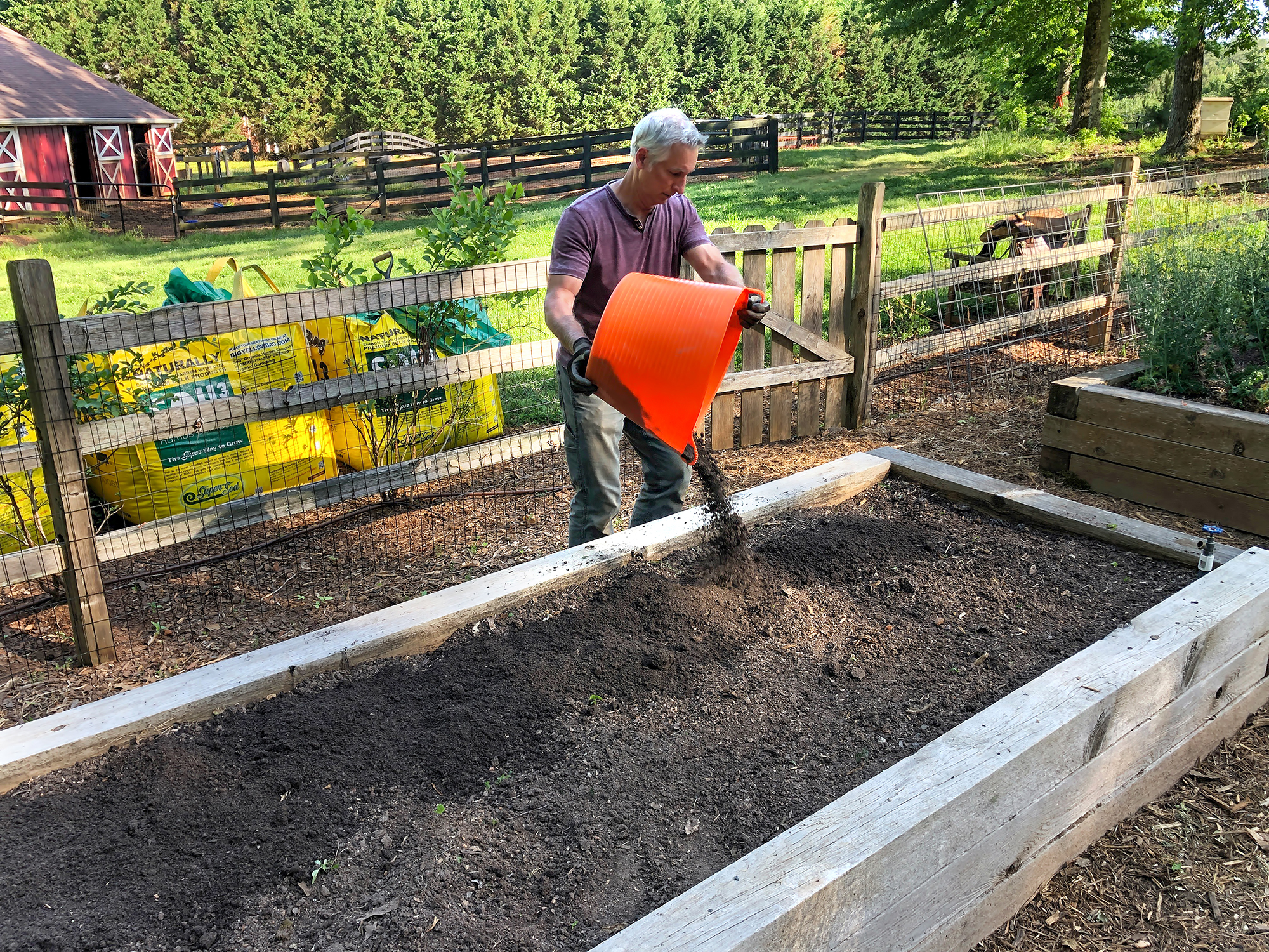 Joe Lamp'l topping off his raised beds with Soil3 compost